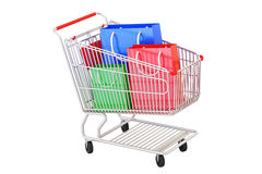 Shopping cart with shopping bags, 3D rendering Royalty Free Stock Photography