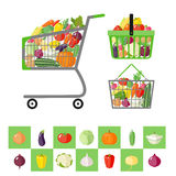Shopping cart and shopping baskets with vegetables Royalty Free Stock Images