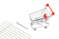 Shopping cart and shopping list Royalty Free Stock Images