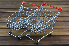 Shopping cart small toy. On wood Stock Images