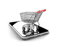 Shopping cart with smart phone of black glass Royalty Free Stock Image