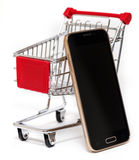 Shopping cart and smart phone isolated Royalty Free Stock Photos