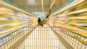 Shopping cart speeding Stock Photography