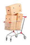 Shopping cart and stack of cardboard boxes Royalty Free Stock Images