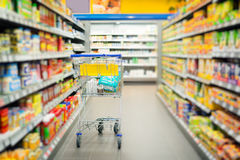 Shopping Cart Standing In Supermarket Stock Photos