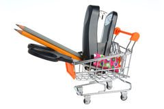 Shopping cart and stationery within isolated on white Stock Image