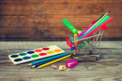 Shopping cart with stationery objects. Stock Image