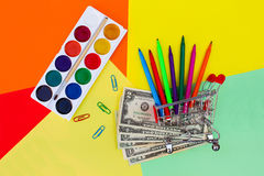 Shopping cart with stationery objects. Office and school supplies. Stock Photo