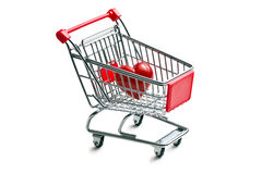 Shopping cart with stone heart Royalty Free Stock Images