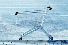 Shopping cart in a store parking lot stock photo