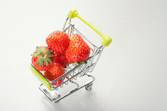Shopping cart of strawberries Stock Photos