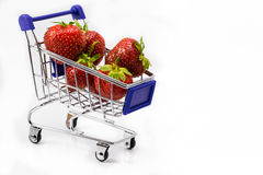 Shopping cart an strawberry Stock Photography