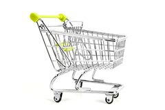 Shopping cart on studio. Picture of shopping cart on studio, isolated on white background Stock Photos