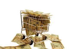 Shopping Cart stuffed money. Shopping cart made of metal used for carrying groceries stuffed with Money in the form of many large bills Stock Photography