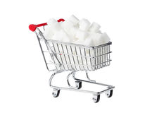 Shopping cart with sugar cubes. One shopping cart filled with sugar cubes isolated on white Royalty Free Stock Photo