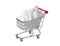 Shopping cart with sugar cubes. One shopping cart filled with sugar cubes isolated on white Royalty Free Stock Images