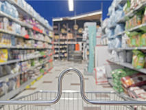 Shopping cart in a supermarket. Shopping cart in the supermarket Royalty Free Stock Photos