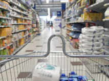 Shopping cart in a supermarket Stock Photography