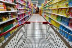 Shopping cart in supermarket Royalty Free Stock Image