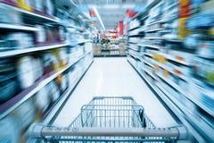 Shopping cart and supermarket background. Blurred supermarket background and shopping cart Stock Photo