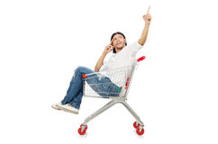 Shopping cart with supermarket Stock Image