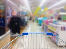 Supermarket in blurry for background. Shopping cart with supermarket in blurry for background Royalty Free Stock Photography