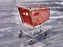 Shopping cart sureal HDR. HDR sureal photo of a lone shopping card in a parking lot Royalty Free Stock Images