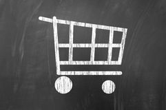 Shopping cart symbol on blackboard Royalty Free Stock Image