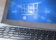 Shopping cart symbol on laptop Stock Image