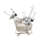 Shopping cart with syringes Royalty Free Stock Photos