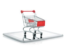 Shopping cart on tablet pc Royalty Free Stock Images