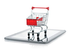 Shopping cart on tablet pc Stock Photos