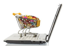 Shopping cart with tablets and computers. Photo icon for the purchase of drugs on the internet Royalty Free Stock Photo