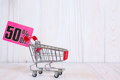 Shopping cart with tag of discount Stock Photos