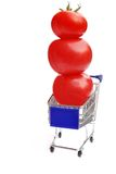 Shopping cart with three tomatoes in balance Stock Photography