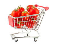 Shopping cart with tomatoes. Ripe red tomatoes in shopping cart  on white background Royalty Free Stock Photo