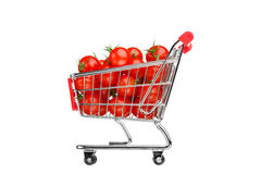 Shopping cart with tomatoes Royalty Free Stock Images