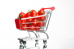 Shopping cart with tomatoes Royalty Free Stock Photo