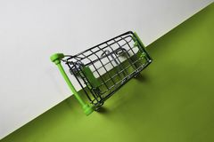 Shopping Cart on top view office desk table of Business workplace and business objects royalty free stock photography