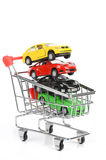 Shopping cart and toy car Royalty Free Stock Images
