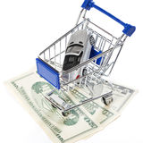 Shopping cart with toy car and money dollars Royalty Free Stock Image