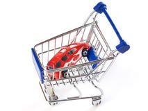 Shopping cart with toy car Stock Photos