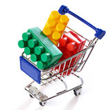 Shopping cart with toy colorful plastic blocks Stock Photography