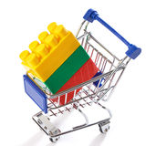Shopping cart with toy colorful plastic blocks Royalty Free Stock Photography