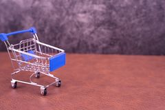 Shopping cart toy for online shopping concept stock images