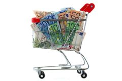 A shopping cart trolley full of Euro Banknote. S, isolated on white Royalty Free Stock Photography