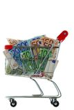 A shopping cart trolley full of Euro Banknote. Closeup of a shopping cart trolley full of Euro Banknotes, isolated on white Stock Photos