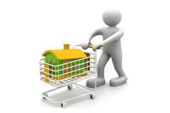 Shopping cart trolley with house. With business man Royalty Free Stock Photos