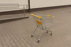 Shopping cart trolley standing outside. Royalty Free Stock Photography