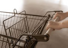 Shopping cart trolley supermarket in a vintage style. royalty free stock photos